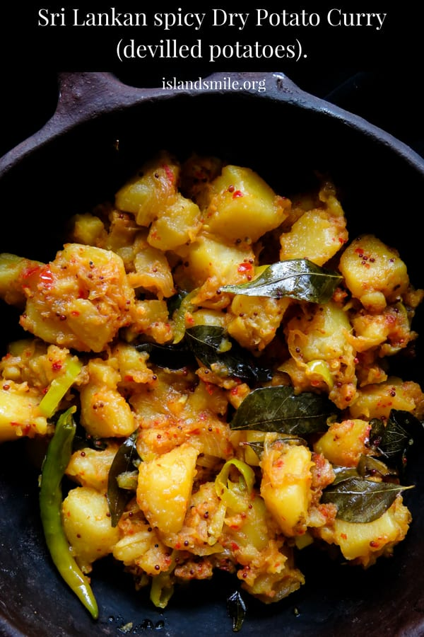 "Sri Lankan spicy dry potato curry(deviled potatoes). An easy to make fried potato curry(ala theldala)for you to try. Boiled potato mixed in fried onions, curry leaves, mustard and loads of red chilli flakes, the name definitely""deviled"" exactly describes the dish."