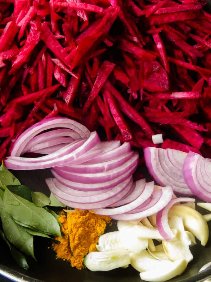 ingredients to make beetroot curry in a pan.