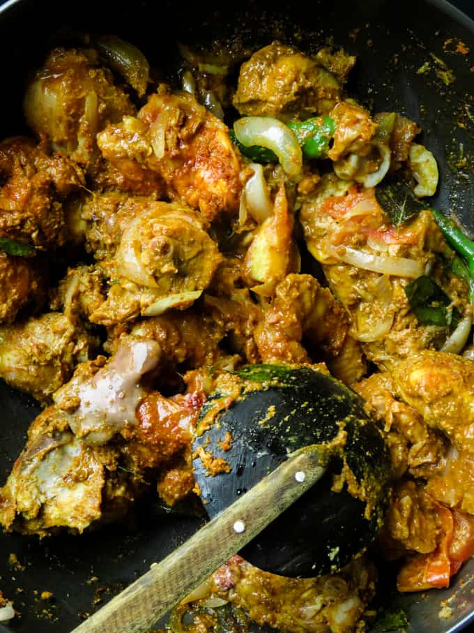 mixed chicken with the tempering spices for the chicken curry.