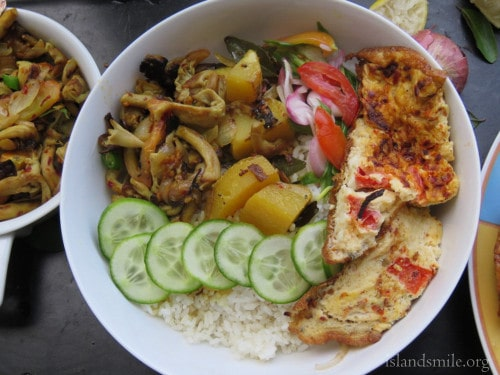 rice, stirfried mushrooms,spring onion salad, cucumbers, potatoes cooked in coconut milk and spicy omelette