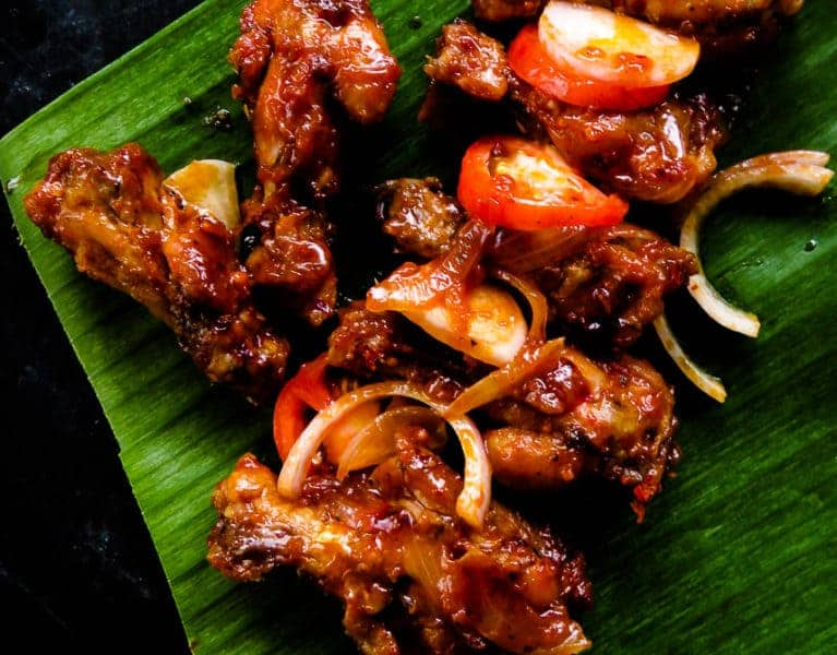 Pan-fried spicy chicken wings. Also known as Sri Lankan devil wings. It takes minutes to marinate and lock in flavors. A perfect appetizer in a rush that you could put together with a few ingredients. finger food for game nights, and parties.