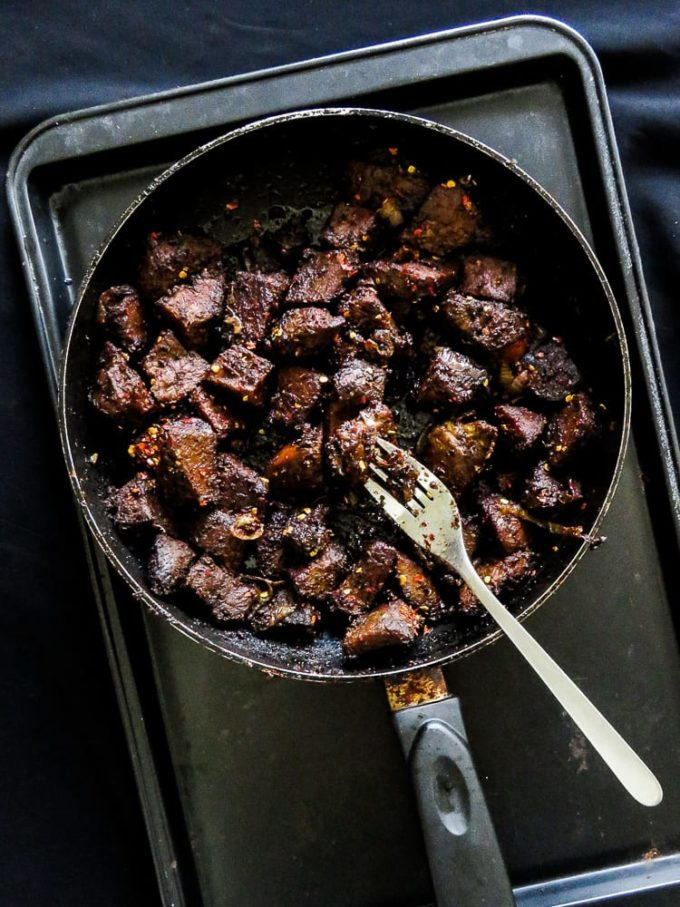 A Sri Lankan style black pepper fry. Have it with a plate of rice and curry, slice into smaller pieces they make the perfect filling for bread, buns, hot dogs, Tortillas anytime. Refrigerate it and the Beef can be used up to three weeks.