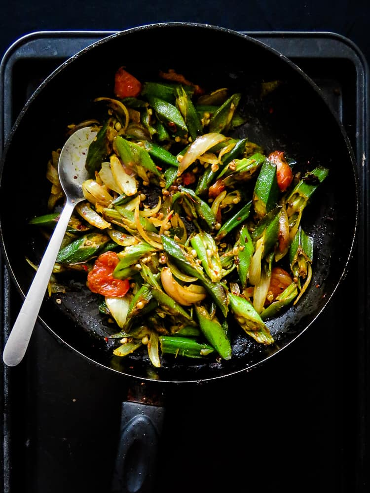 Sri Lankan Lady's fingers(okra) stir-fry, a vegan, vegetarian, green side-dish made in minutes. Try it, you might be surprised how good it tastes.-islandsmile.org