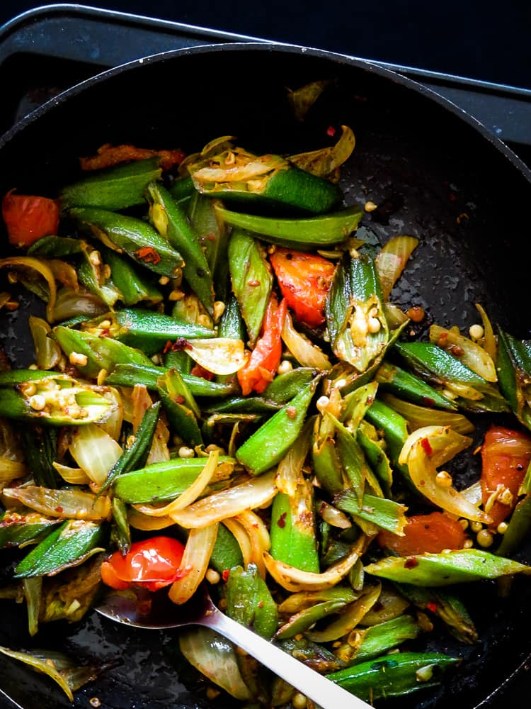 Sri Lankan Lady's fingers(okra) stir-fry, a vegan, vegetarian, green side-dish made in minutes. Try it, you might be surprised how good it tastes. #okra #vegetarian #vegan #glutenfree #lowcarb #stirfry #srilankan #sidedish
