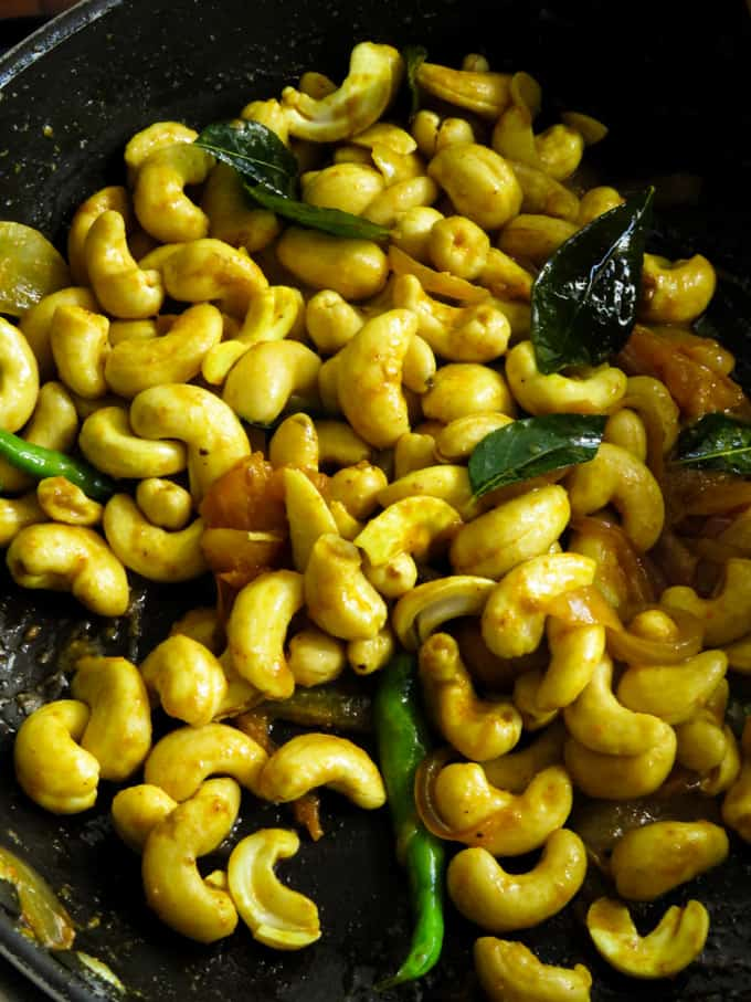 stir fried cashews for the kaju curry.