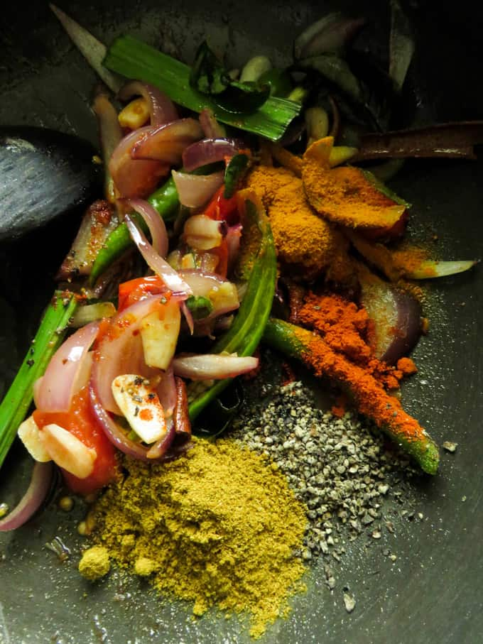 ingredients tempered for canned sri lankan fish curry.