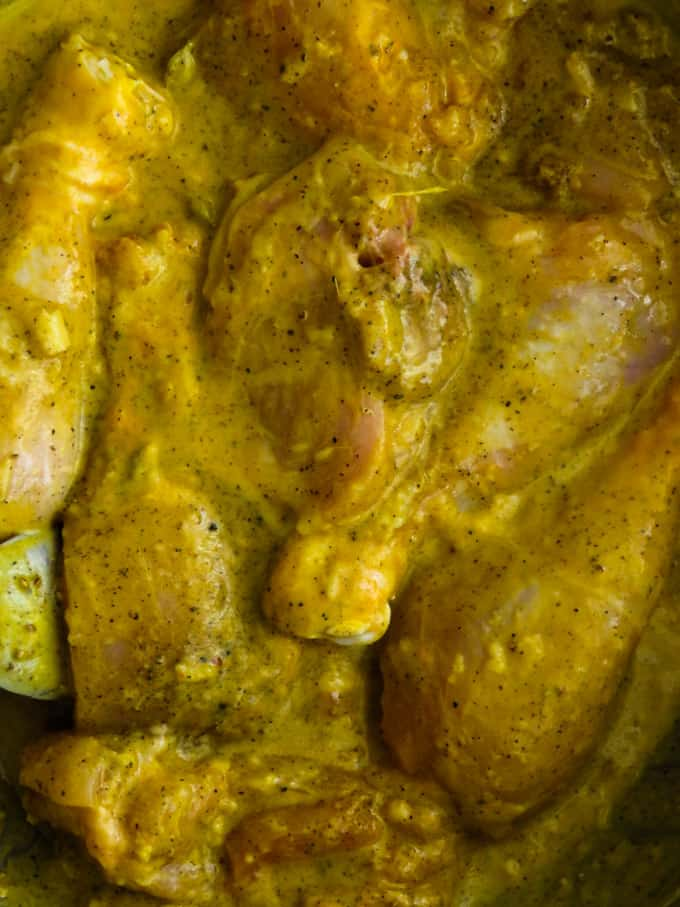 mix and combine the yoghurt spice marinade in the chicken.