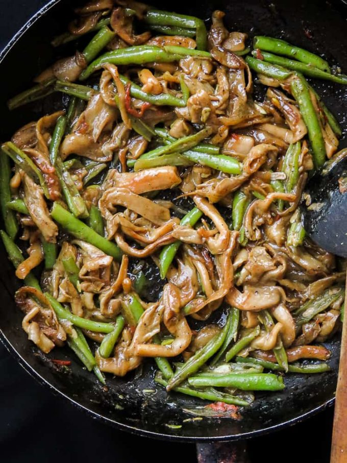 oyster mushroom and green bean stir-fry in a frying pan.