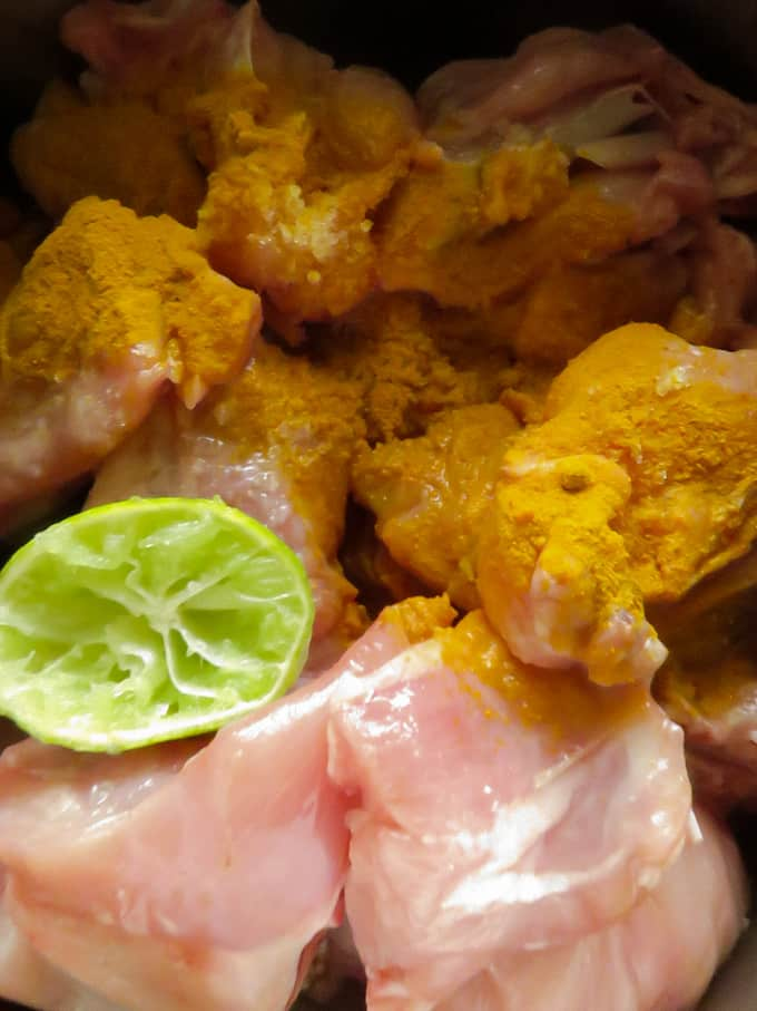 chicken marinated with turmeric,salt and lime juice to make chicken chukka(sukka).