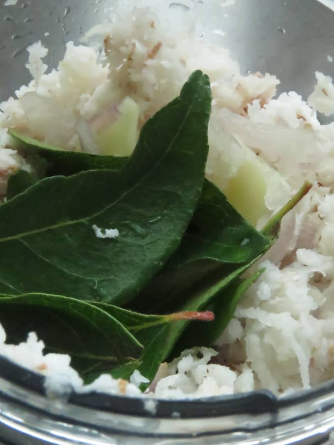 grinding onion, garlic,grated coconut and curry leaves.