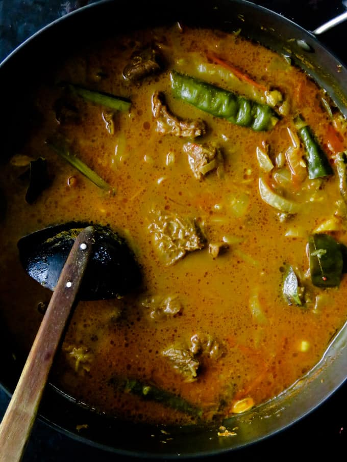 cooking with thin milk for the beef curry.