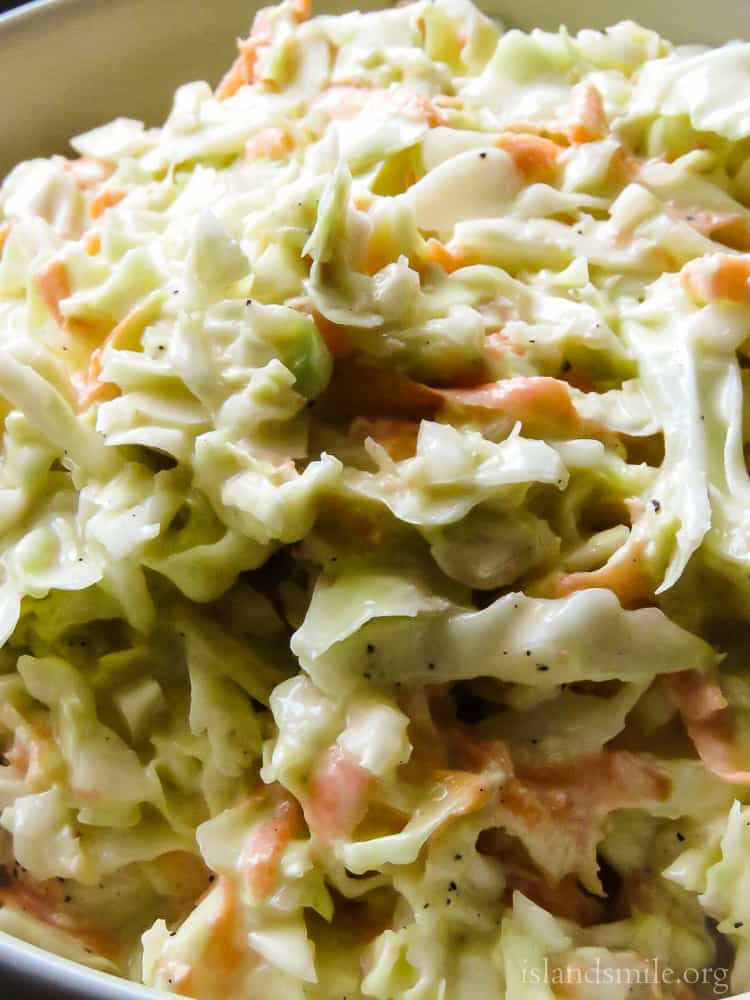 Homemade creamy coleslaw salad with mayonnaise, a classic salad to go with everything you dish out at picnics, especially grilled meats and burgers. an easy salad for all seasons and occasions.www.islandsmile.org