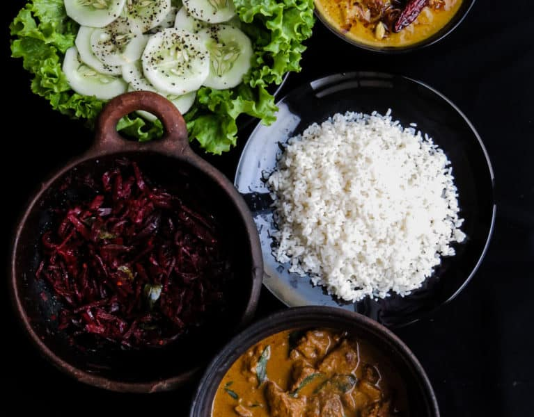 Sri Lankan Lunch meal plan 1- rice, mildly spiced beetroot curry, slow cooked beef made just like my grandmother used to make, pumpkin curry cooked in coconut milk, a few slices of Cucumber in a bed of salad leaves-islandsmile.org
