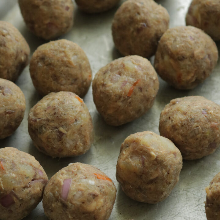 Shaping the fish cutlets into small balls.