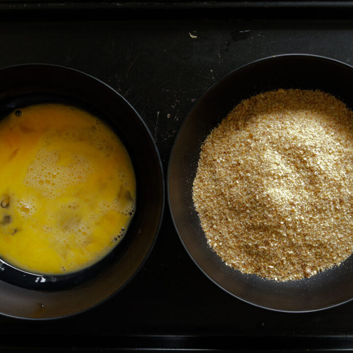 egg and breadcrumbs set to bread and coat the fish cutlets.