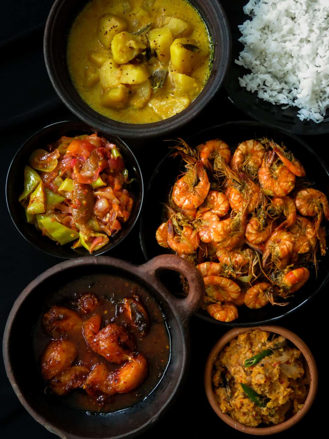 Sri Lankan meal plan 2- Rice with a prawn curry cooked in coconut milk, tempered-dry spicy dhal, capsicum with pickled lime sambol, a creamy potato milk curry and a sweet and spicy ambarella curry makes up this five dish menu.-islandsmile.org