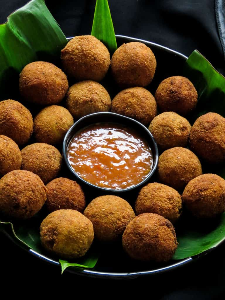 Deep-fried Sri Lankan fish cutlets, a spicy, savory bite served a sweet and spicy sauce.