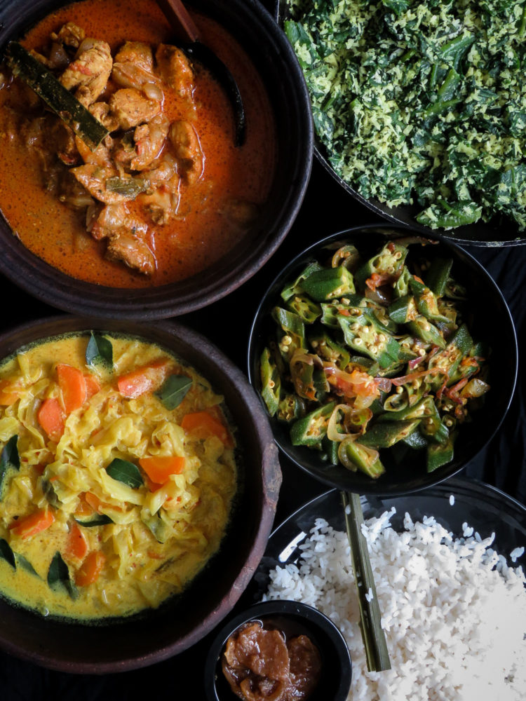 Sri Lankan meal plan 3- Spicy Chicken curry cooked with Srilankan spices, a creamy, coconut milk based cabbage and carrot curry, spicy stir-fried okra, a spinach- coconut mallung with lime pickle completes this easy menu-islandsmile.org