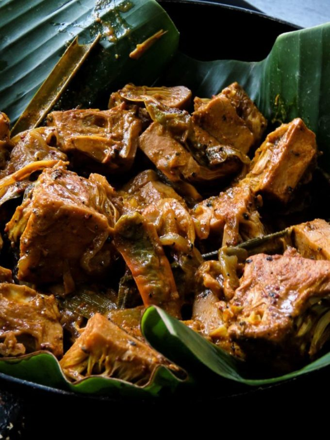 Sri Lankan-vegan young/green jackfruit curry also known as Ambul Polos in Sinhalese. Enjoy a meatless meal just by adding polos curry to your menu. #greenjackfruit #babyjackfruit #vegan #vegetarian #glutenfree #slowcooked #srilankan #srialnkanfood