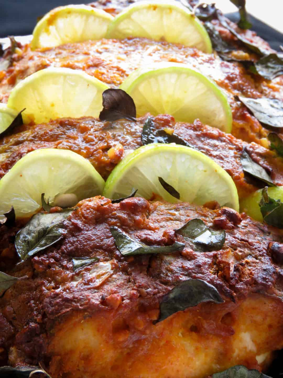 How to make tandoori masala fish(oven-baked, healthy, Indian)- You'll love how the tandoori marinade flavors the fish, once baked, you get a crispy skin with tender, moist fish to savor every bite, a drizzle of lime is all you need-islandsmile.org