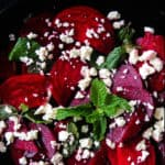 Raw beetroot-feta salad with pomegranate dressing- a beautiful salad, a pop of color on your table but also healthy and light. just 15-20 minutes from the time you peel, slice and assemble-islandsmile.org