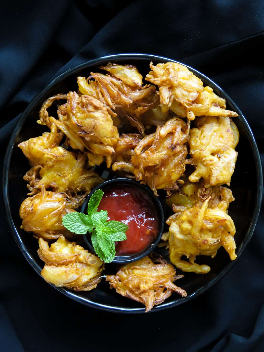 Crispy deep-fried onion fritters- light, crunchy and ideal for any time of the day, serve this savory bites as an appetizer or snack. all you have to do is mix the ingredients in a bowl and start deep-frying-islandsmile.org