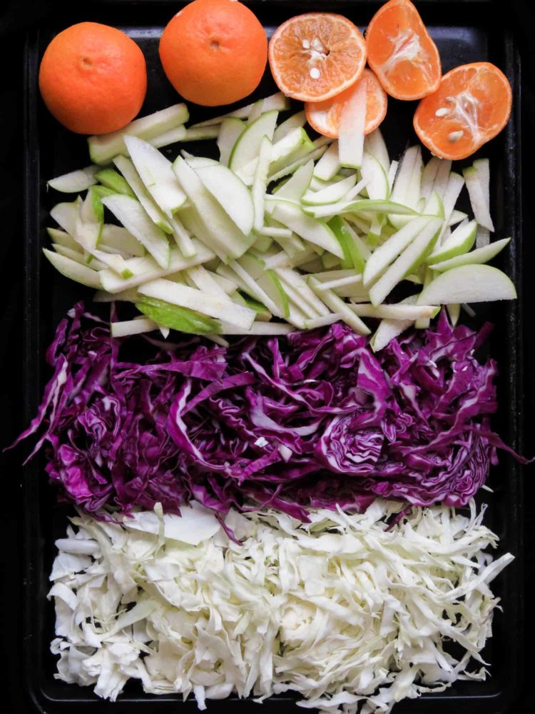 Raw cabbage and apple coleslaw- a crunchy vegan, vegetarian, gluten-free, easy salad that's not only healthy but makes a lovely colorful healthy addition to your table. my kids loved it and hopefully, yours will too.-islandsmile.org