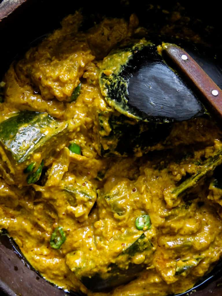 "Sri Lankan pumpkin curry in roasted coconut also known as ""kalu pol wattakka"", a much more creamier, thicker pumpkin curry than what you'll be accustomed to, try it."