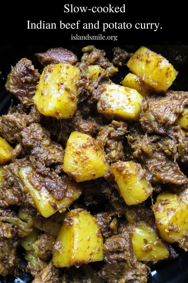 Tasty Indian beef and potato curry- tender meat and potatoes cooked in spices to flavor the dry gravy. this rich curry just needs a few garlic naans, roti or paratha to serve as a meal.