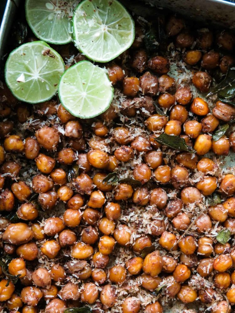 healthy oven-roasted curry chickpeas can be a snack, breakfast or topped over a simple meal. add a pinch of homemade garam masala to give these easy chickpeas a curry flavor you'll enjoy.