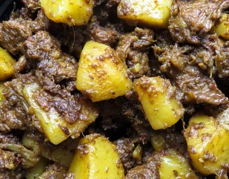 Tasty Indian beef and potato curry(alu gosht)- tender meat and potatoes cooked in spices to flavor the dry gravy. this rich curry just needs a few garlic naans, roti or paratha to serve as a meal-islandsmile.org