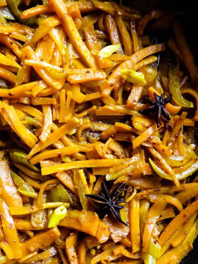 Pan-fried spicy carrots(Sri Lankan). Infused with star anise, this easy, gluten-free, vegan, vegetarian dish makes the perfect side dish for any meal. #carrots #stirfry #Srilankan