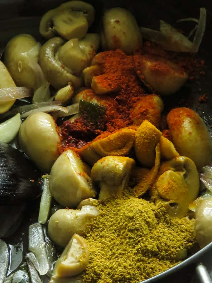 adding spices for the mushroom curry.