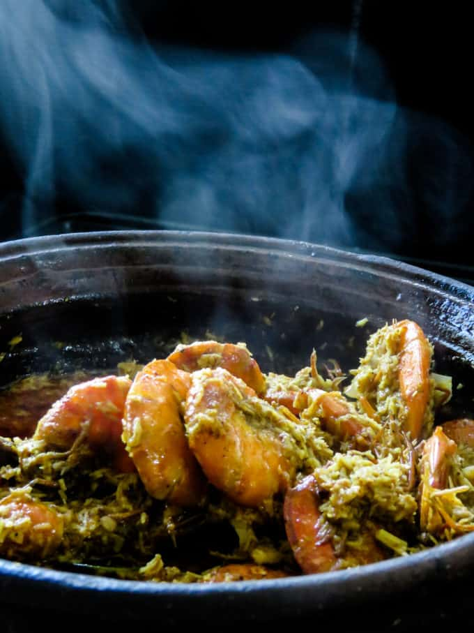 coconut-shrimp curry ina clay pot with aromatic flavors from the spice and coconut.