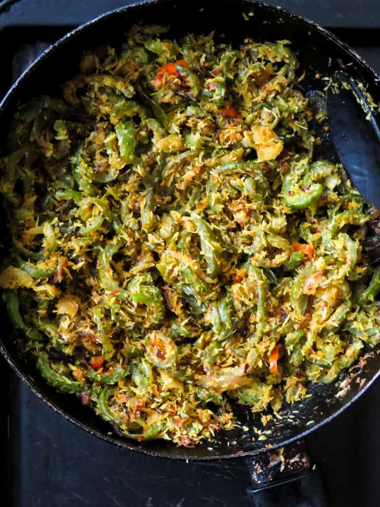 Sri Lankan snake gourd stir-fry(patholamallung)- Next time you pass by a farmers market or a vegetable stall pick up a snake gourd to make this easy vegan, vegetarian stir-fry.