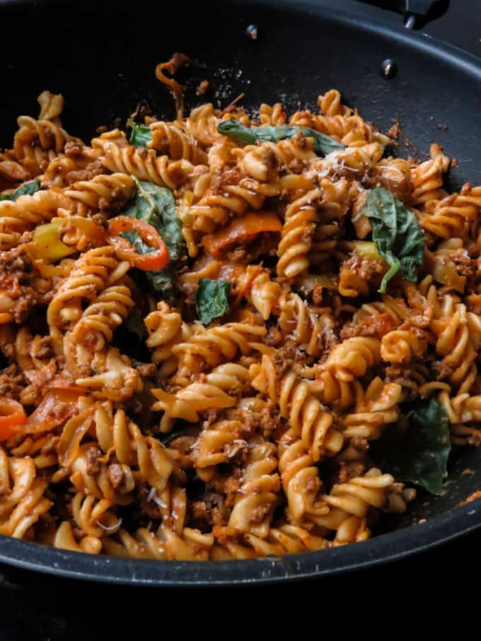 Easy spicy ground beef pasta. A spicy version of your regular beef and pasta dish. It's a one-pot meal you can serve straight from the stove to the dinner table. #beef #spicy #ground beef #onepot #skillet #dinner #quick #easy.