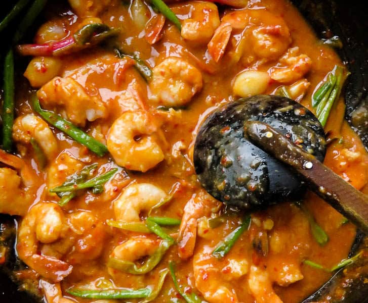 A skillet seafood stir-fry for you spicy lovers out there. Shrimp cooked in a Sriracha-coconut milk based sauce. Serve as a side-dish for the pescetarian in your family. It's an easy shrimp dish to make for the whole family. #shrimp #spicy #skillet #easy #sriracha #mealprep #dinner