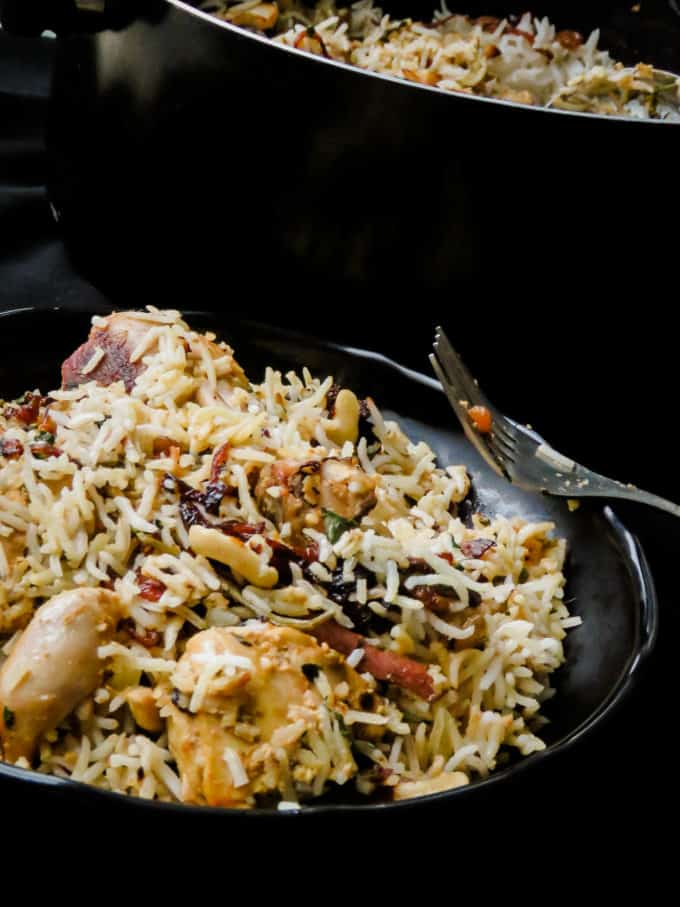 A  step by step for the absolute beginner wanting to make a Hyderabadi chicken biryani over a stove-top. layers of rice and chicken marinated in Indian spices makes a one of a kind dish for all festivities. #rice #biryani #hyderbadi #onepot #howto #lunch #meal #stovetop #Indian
