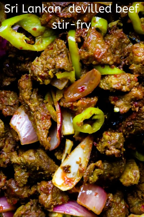 Sri Lankan spicy devilled beef stir-fry. Tender beef tossed in a mix of spicy ingredients to give you this over the top hot dish. a meal in a wrap for a quick dinner. #beef #stir-dry #devilled #quick #appetizer #glutenfree #lowcarb #spicy #srilankan