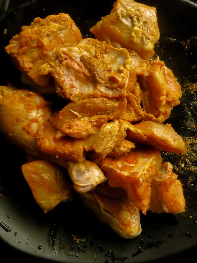 marinated chicken parts to make the sri lankan chicken curry.