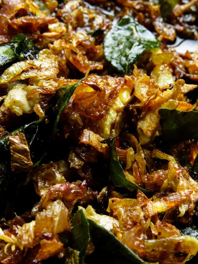 Also known as keselmuwa seeni sambol-a vegan/vegetarian delicacy you won't be able to resist.if you haven't made fried banana flower seeni sambolthen you should try making this rice puller. #vegan #vegetaran #srilankan #fry #bananaflower #glutenfree.