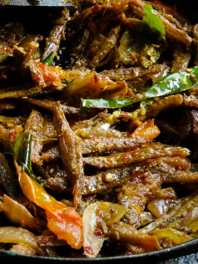 Sri Lankan dry sprats tempered in tomato and onion fry. When you think of Sri Lankan village type rice and curry, a tempered sprat fry would be the best side-dish to the menu.