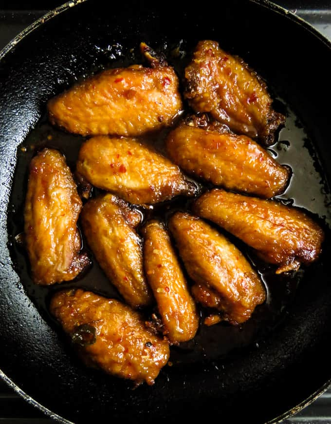 "spicy pan-fried chicken wings in teriyaki sauce.- smothered in a sticky, spicy sauce. These chicken wings give new meaning to""finger licking good"".  They are better than restaurant wings you can make, pile up and serve as an appetizer, tailgating snack."