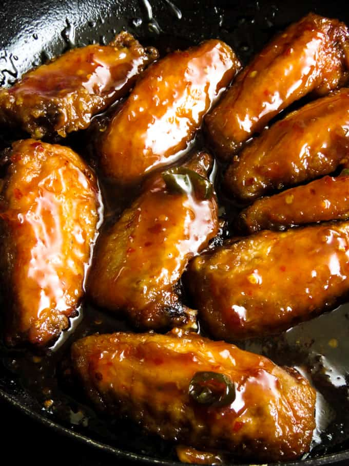 "spicy pan-fried chicken wings in teriyaki sauce.- smothered in a sticky, spicy sauce. These chicken wings give new meaning to""finger licking good""."