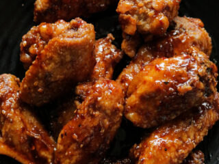 spicy pan-fried chicken wings in teriyaki sauce.- smothered in a sticky, spicy sauce. These chicken wings give new meaning to