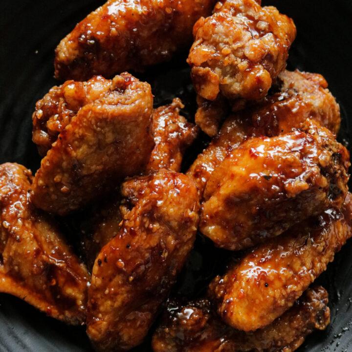 spicy pan fried chicken wings in teriyaki sauce.