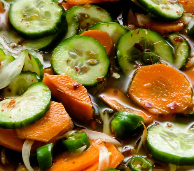 quick pickled cucumber and carrot relish. A spicy, sweet and sour cucumber salad to serve with all your grilled meats or just to munch on.