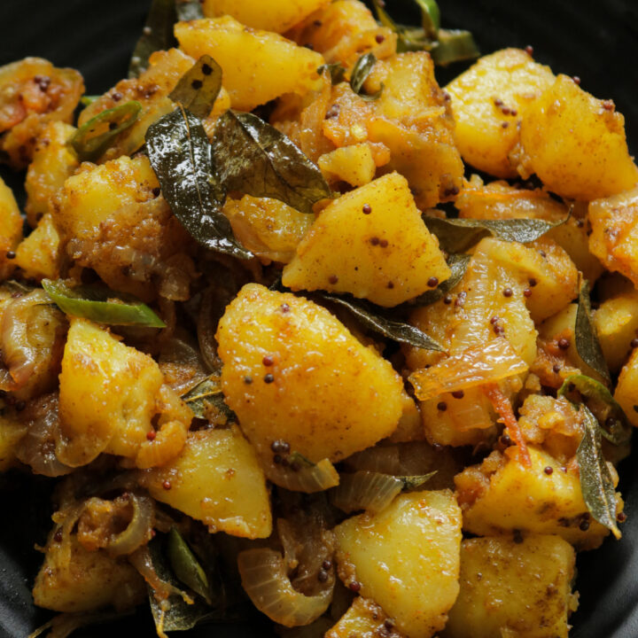 served bombay potatoes in a platter