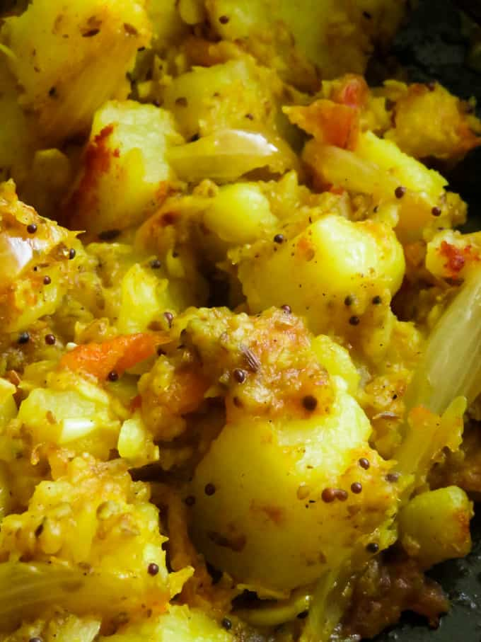 Indian Bombay potatoes(cumin-spiced). A  curry potato(Bombay aloo)recipe with loads of cumin and turmeric give these spuds the quintessential Indian flavor.