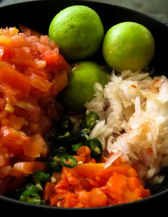 All the ingredients you need to make a spicy chunky tomato onions salsa.